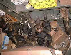 Cosmolined military vehicle engine parts overflow from shelves.