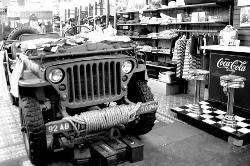 Army Navy Surplus Store with a WWII Jeep on display