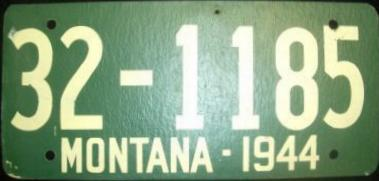 1944 Montana Remade License Plate over 1943 IL fiberboard License Plate