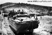A DUKW heads off across the sand following a road of PSP (Perforated Steel Planking) Sand Mats.