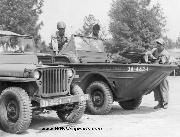 A Jeep and a Ford GPA Amphibian being serviced in the motor pool at Camp Shelby, Mississippi. 7/1943.