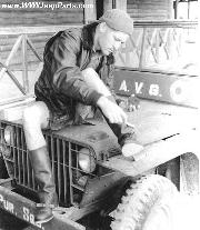 AVG Pilot Dick Rossi polishing boots on hood of squadrons 1941 2nd series Ford GP prototype Jeep Feb. 1942 Mingladon Airfield, Rangoon