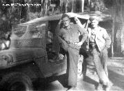 Unknown GI standing in the drivers side. My dad, Pfc. Myles A. Schauer, to the right.