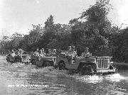General Stilwell leading a group of Jeeps across a river in a 1942 Ford GPW.  See article above.