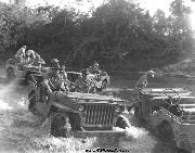 General Stilwell sitting in a 1942 Ford GPW along side another GPW.