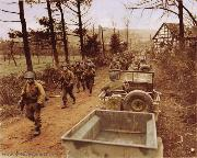 1st Infantry Division Jeeps and Jeep Trailers of the 'Big Red One' move into the Fatherland. Infantrymen of Company C, 1st Battalion, 18th Infantry Regiment enter into Frauwullesheim, Germany, February, 28, 1945.