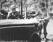 Delivering mail from a jeep of the 442nd RCT. Notice leather rifle scabbard and windshield cover