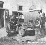 Mechanics installing a permanent hard top on a WWII Jeep in the motorpool area of the 461st Bomb Group, 15th AAF.