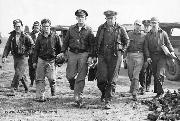 US Airmen return to England from a raid over Europe. The crew of an Amercian flying fortress bomber named Dry Martini make their way to the interrogation room to relay news of their completed mission.