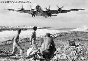 WWII Jeep and a B-29 Bomber taking off from Saipan, Dec. 1944
