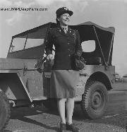 WAAC Deputy Director Major Betty Bandel standing in front of a jeep