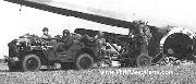 British Airborne Commandos unload their jeep and towed 20mm Cannon from their crashed glider.