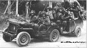 British Airborne Commandos in a loaded down WWII Jeep and English Trailer