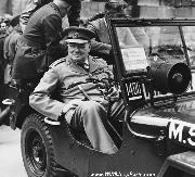 Prime Minister Winston Churchill sits in a military jeep during a tour of the ruined Reichstag in Berlin on July 16, 1945