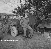 Early Canadian Militatary Jeep. Notice Solid Rims and use of burlap strip Camo Net.