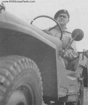 Early Canadian Military Jeep. Notice Solid Rims, and short Mirror Arm.