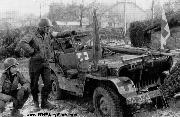 Jeep Ambulance of the Medical Detachment of the 32rd Armored Regiment, 3rd Armored Division, note extra Geneva Convention markings