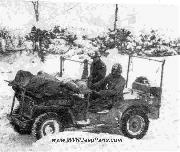 Evacuation during the Battle of the Bulge by 1/4-Ton Truck Jeep Ambulance in deep snow by the Medical Detachment personnel of the 393d Infantry Regiment in the vicinity of Monschau. During the winter of 1944-45, jeeps were used extensively for medical evacuation in the ETO.