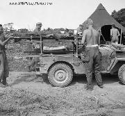Wounded GI's strapped to their litters are placed aboard a converted jeep for transportation to the rear from the fighting zone on Okinawa, Japan.