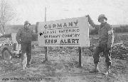 Two medics from the 740th Field Artillery Battalion at the Entering Germany Sign, East of St. Vith, Belgium, 31 October 1944