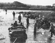 Jeep Ambulance bringing wounded back across the Moselle.