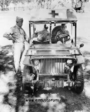 Captain Nelson inspecting a half-ton jeep with a permanent metal frame for carrying three litters somewhere in Australia. 1942.