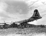 Jeeps surround a A B-29 Superfortress that rests on a dirt mound after it crash landed with two engines working at Iwo Jima, Japan during World War II. The U.S. Army Air Force plane was damaged in a raid over Tokyo. April 21, 1945. Notice Fender