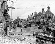 American convoys passing the ruined city of Isigny on Wed, July 4th, 1944.