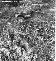 Dead Japanese soldiers on Saipan next to their now burned out captured Jeep. When one of their party was killed by shellfire from American guns on Saipan Island during World War II, the other three Japanese soldiers with him committed suicide.