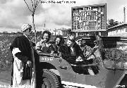 Celebrities in an Army Jeep West of Algiers, Algeria. Martha Raye, Caroll Landis, and Kay Francis ask a local Algerian for directions as they drive toward Algiers.