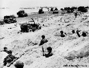 GI's in Foxholes and Jeeps with water fording kit snorkels fill the Normandy Beaches on D-Day.