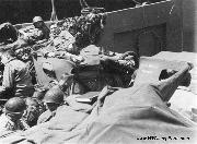 D-Day June 6, 1944. American troops and 1/4-ton jeeps on board a Coast Guard-operated LCT on their way to Utah Beach. The Invasion of the continent is on.