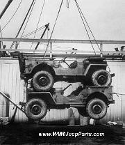 WWII Jeeps double stacked for shippment being loaded on a cargo ship.