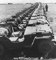 A row of Willys MB and Ford GPW Jeeps sit in the ETO before their planned shipment to the PTO to continue fighting the war on Japan.