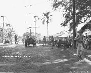 Early Jeep and Anti-tank guns of the defending forces in maneuvers at Liliha and Judd Streets, T.H. Territory of Hawaii