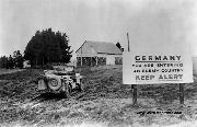 WWII Jeep at the Entering Germany Sign