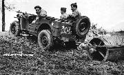 American troops use jeeps to clear and plow thousands of acres of land at Army camps and depots as part of a large-scale agricultural program in cooperation with the British Army. Notice it is an early Ford Script GPW.