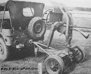 Early Ford Script GPW Jeep towing a .50cal Anti-Aircraft Gun.