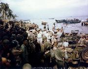 General Douglas MacArthur inspects the Leyte beachhead, Oct. 1944. Notice the jeeps with water fording equipment.