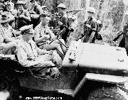 Pushing through New Guinea jungles in a jeep, General Douglas MacArthur inspects the positions and movements of Allied Forces, who would push the Japanese away from Port Moresby and back over the Owen Stanley Mountain range.Nov. 3, 1942