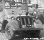 General Patton's Jeep of 3rd Army HQ. Notice electric Windshield Defroster in position on driver's windshield. Also, jeep has both General's License Plate and Flag. Air horns, and air tank (behind front bumper), as well as fender mud flaps, cowling, and doors modifications.