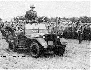 General Patton inspects troops from his modified jeep War Eagle.