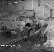 A late war jeep getting a cleaning.