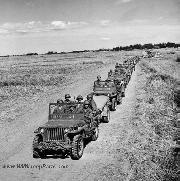 American Soldiers driving in jeeps to Manila on March 01, 1945 for Troop Rescue. Soldiers from the First Cavalry Division of the United States Army drive toward Manila to release American and Allied nationals held in Santo Tomas Internment Camp, near Manila, Philippines.