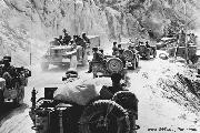 U.S. troops travel deep into Sicily on August 17, 1943. Italian forces surrendered one month later. Near Nicosia, Sicily.