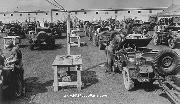 Jeeps and trailers being processed for overseas shipment and amphibious driving, Hampton Roads Port of Embarkation, 11 May 1943.