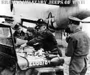 General Eisenhower having lunch on the hood of a Jeep at an AAF base.  Notice bullet shape siren on right fender of jeep.
