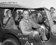 Eddie Rickenbacker rides in a jeep after his rescue. 11/24/1942.