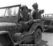 Marine Lt. Gen. Holland M. Howlin' Mad Smith tours a captured airfield on Saipan in a jeep. July 1944. Notice shovel and ax.