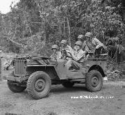 A telephone trouble-shooting crew of Marine A-P hops into a jeep and moves out to the scene of communications trouble on Guadalcanal. Notice Marire Corps Lifting Rings and  Ram's Horn Tow Hooks.